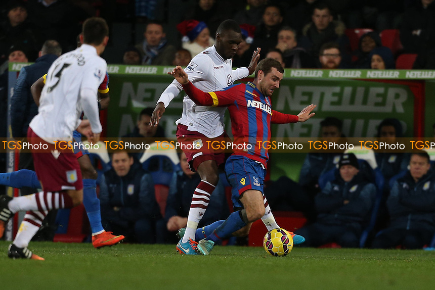 Christian Benteke of Aston Villa challenges James McArthur of Crystal Palace - Crystal Palace vs Aston Villa - Barclays Premier League Football at Selhurst Park, London - 02/12/14 - MANDATORY CREDIT: Simon Roe/TGSPHOTO - Self billing applies where appropriate - contact@tgsphoto.co.uk - NO UNPAID USE