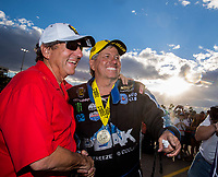 Oct 30, 2016; Las Vegas, NV, USA; NHRA funny car driver John Force (right) with NHRA team owner Don Schumacher during the Toyota Nationals at The Strip at Las Vegas Motor Speedway. Mandatory Credit: Mark J. Rebilas-USA TODAY Sports