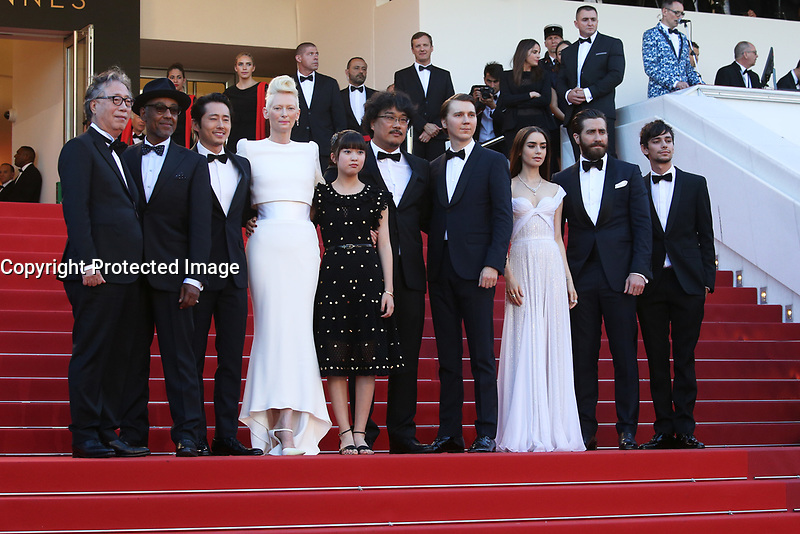 BYUNG HEEBONG, GUEST, STEVEN YEUN, TILDA SWINTON, AHN SEO-HYUN, DIRECTOR BONG JOON-HO, PAUL DANO, LILY COLLINS, JAKE GYLLENHAAL AND DEVON BOSTICK - RED CARPET OF THE FILM 'OKJA' AT THE 70TH FESTIVAL OF CANNES 2017