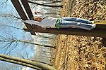 Girl, 8, on high bars in winter woods