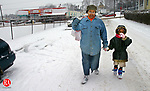 WATERBURY, CT. 02 March 2006-030206SV06--Tawanna Key and her daughter JeMaya Key, 6, head home after picking up some groceries during a snow storm Thursday.<br /> Steven Valenti Republican-American