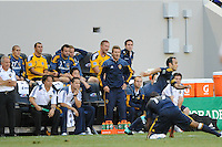 David Beckham (23) of the Los Angeles Galaxy (standing center) encourages teammates from the bench during a Major League Soccer (MLS) match against the New York Red Bulls at Red Bull Arena in Harrison, NJ, on August 14, 2010.