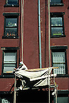 PAINTER ON SCAFFOLD REPAIRS APARTMENT BUILDING IN BROOKLYN NY