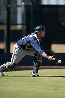 Milwaukee Brewers catcher Tanner Norton (13) flips the ball to the pitcher covering home on a passed ball during an Instructional League game against the Los Angeles Angels on October 11, 2013 at Tempe Diablo Stadium Complex in Tempe, Arizona.  (Mike Janes/Four Seam Images)