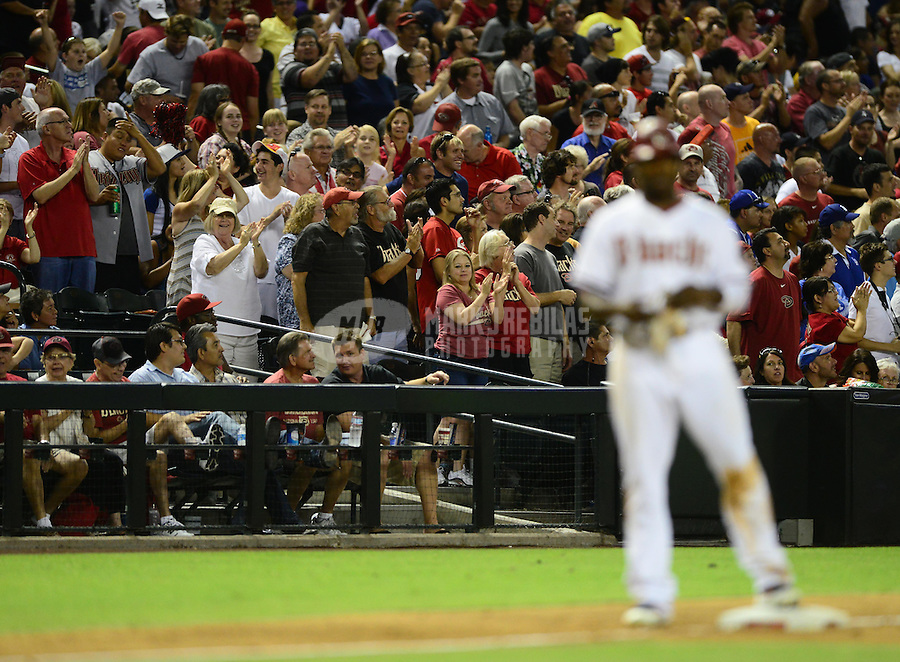 Jul. 6, 2012; Phoenix, AZ, USA: Arizona Diamondbacks fans cheer after outfielder Justin Upton hit a two run triple in the sixth inning against the Los Angeles Dodgers at Chase Field. Mandatory Credit: Mark J. Rebilas-