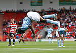 Manchester City's Micah Richards performs a summersault after scoring