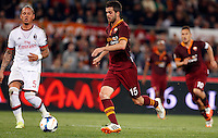 Calcio, Serie A: Roma vs Milan. Roma, stadio Olimpico, 25 aprile 2014.<br /> AS Roma midfielder Miralem Pjanic, of Bosnia, prepares to score as AC Milan defender Philippe Mexes, of France, left, looks on during the Italian Serie A football match between AS Roma and AC Milan at Rome's Olympic stadium, 25 April 2014.<br /> UPDATE IMAGES PRESS/Riccardo De Luca