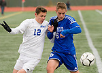 NEW BRITAIN, CT-111817JS18- Lewis Mills' Matt Gilbert (12) Suffield's David Swan (6) run down a loose ball during their Class M state final game Saturday at Willow Brook Park in New Britain.<br /> Jim Shannon Republican-American