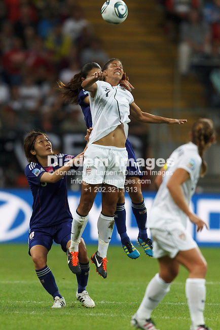 FRANKFURT, GERMANY - JULY 17:  Shannon Boxx of the United States (7) jumps for a header during the FIFA Women's World Cup final against Japan July 17, 2011 at FIFA Women's World Cup Stadium in Frankfurt, Germany.  Editorial use only.  (Photograph by Jonathan P. Larsen)
