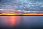 Vashon-Maury Island, Washington: Sunrise over the Cascade Range and Mount Rainier with light reflected in Puget Sound