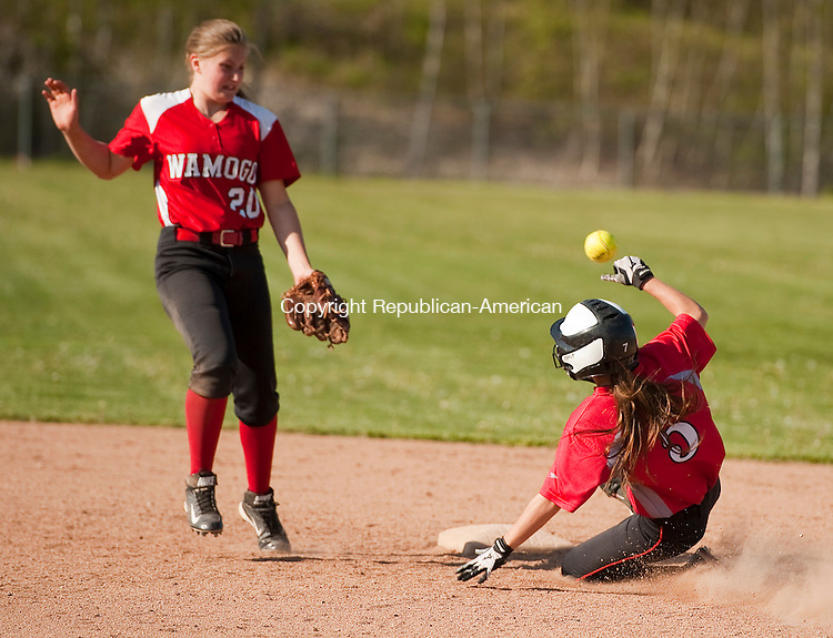 WINSTED,  CT--- -051116JS10- Northwestern's Katie Wald (5) safely steals second base as thee throw to Wamogo's Savannah Wheeler (20) was off the mark during their game Thursday at Northwestern Regional High School in Winsted. <br />  Jim Shannon Republican-American