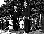 United States President Gerald R. Ford and Chancellor Helmut Schmidt of Germany listen as the Nationals Anthems of their respective countries are played on the South Lawn of the White House in Washington, DC during the Arrival Ceremony on December 5, 1974. Schmidt is scheduled to speak with the President about the oil problem and the economy.  Helmut Schmidt passed away on November 10, 2015 at age 96.<br /> Credit: Barry Soorenko / CNP