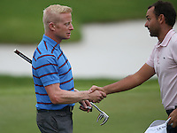 Simon Dyson (ENG) shakes hands with Carlos Del Moral (ESP) as they complete Round Three of The Tshwane Open 2014 at the Els (Copperleaf) Golf Club, City of Tshwane, Pretoria, South Africa. Picture:  David Lloyd / www.golffile.ie
