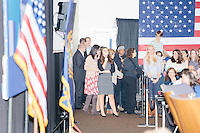 Campaign staffers wait backstage before Democratic presidential candidate and former First Lady and Secretary of State Hillary Rodham Clinton speaks at the Women's Economic Opportunity Summit at Southern New Hampshire University in Hooksett, New Hampshire.