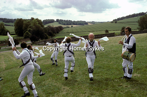 Morris dancers Whitchurch. Buckinghamshire  England man playing Penny Whistle.