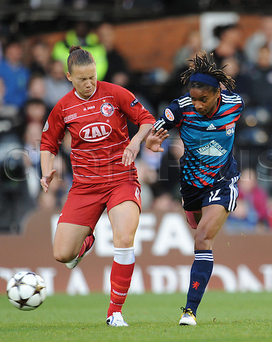 26.05.2011. London England.  Womens Champions League Final from Craven Cottage in London. FFC Turbine Potsdam v Olympique Lyonnais. Lyonnaise won 2-0. Elodie Thomis battles for the ball with a Potsdam defender