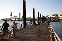 Runners, walkers and bicyclists on the Vera Katz East Bank Esplanade along the Willamette River in Portland Oregon
