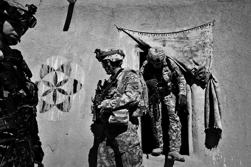 Members of 1/506th Infantry, Baker Company, search houses for weapons in Gabikhel, Paktika Province, Afghanistan, Sunday, Feb. 15, 2009.