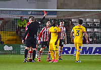 Northampton Town's Junior Morias is shown a red card by referee Graham Salisbury<br /> <br /> Photographer Andrew Vaughan/CameraSport<br /> <br /> Emirates FA Cup First Round - Lincoln City v Northampton Town - Saturday 10th November 2018 - Sincil Bank - Lincoln<br />  <br /> World Copyright &copy; 2018 CameraSport. All rights reserved. 43 Linden Ave. Countesthorpe. Leicester. England. LE8 5PG - Tel: +44 (0) 116 277 4147 - admin@camerasport.com - www.camerasport.com