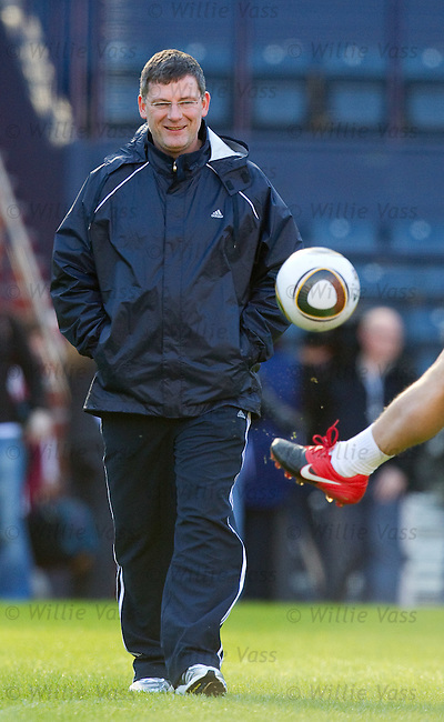 Scotland manager Craig Levein walks out onto the Hampden training pitch for the first time