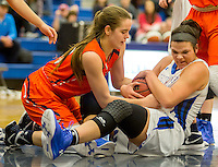 NWA Democrat-Gazette/JASON IVESTER<br /> Madison Sandor (right), Rogers High junior, and Rogers Heritage senior Dehring Scudder vie for a loose ball on Tuesday, Jan. 12, 2016, at Rogers High.