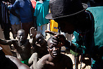18 december 2010 - Juba, Southern Sudan - Members of the Mundari tribe from Central Equatoria State before the final of South Sudan's first commercial wrestling league between their tribe and the Dinka wrestlers from Bor, Jonglei State at Juba Stadium. The matches attracted large numbers of spectators who sang, played drums and danced in support of their favorite wrestlers. The match organizers hoped that the traditional sport would bring together South Sudan's many different tribes. Photo credit: Benedicte Desrus