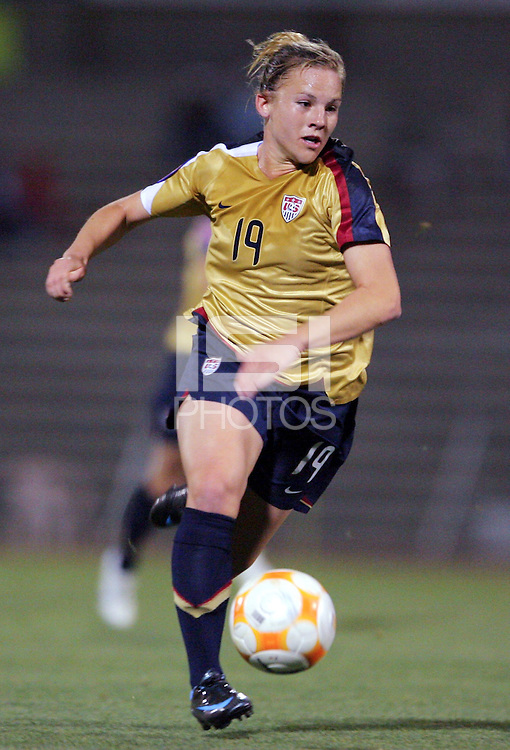 Action photo of Amy Rodriguez of USA, during game of the Womens Preolympic soccer tournament held at Ciudad Juarez. Mexico