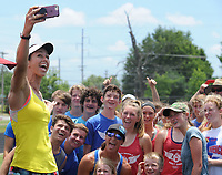 NWA Democrat-Gazette/ANDY SHUPE<br /> April Steiner Bennett (left), a former Arkansas and Olympic pole vaulter, takes a selfie with campers Friday, June 16, 2017, during a break in instruction for pole vaulters at Ramay Junior High School in Fayetteville. Steiner Bennett and Stacy Dragila, a former Olympic pole vaulter and 2000 Olympic gold medalist, were on hand for two days of intensive instruction for vaulters from elementary to high school.