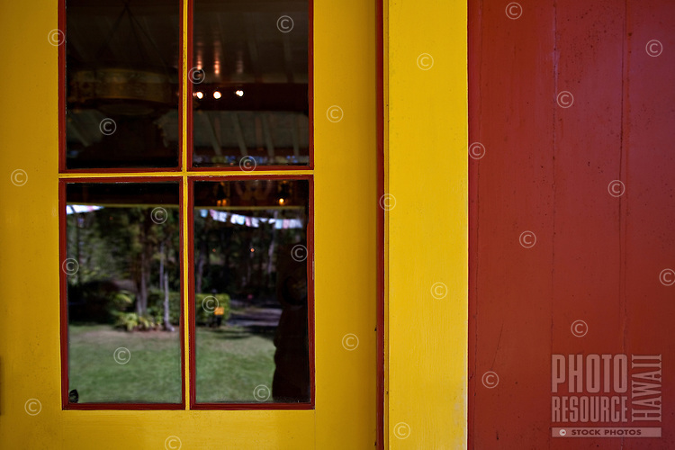 Reflections in door to Buddhist Temple in Wood Valley on the Big Island of Hawaii
