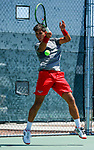 SURPRISE, AZ - MAY 12: Carlos Gomez of the Barry Buccaneers returns a ball against Zach Whaanga of the Columbus State Cougars during the Division II Men's Tennis Championship held at the Surprise Tennis & Racquet Club on May 12, 2018 in Surprise, Arizona. (Photo by Jack Dempsey/NCAA Photos via Getty Images)