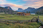 Bridger-Teton National Forest, Wyoming:<br /> Abandoned log cabins under the profile of the Wind River range