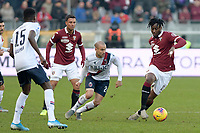 12th January 2020; Olympic Grande Torino Stadium, Turin, Piedmont, Italy; Serie A Football, Torino versus Bologna; Soualiho Meite of Torino FC shields the ball from Rodrigo Palacio of Bologna - Editorial Use