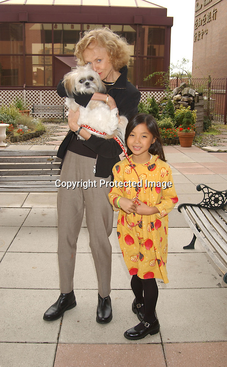 ..Jill Larson and daughter Annie Ming and Snowy ..at Animal Haven's 36th Annual Going Home Luncheon ..on October 19, 2003 at the Sheraton LaGuardia East Hotel in Flushing New York. Photo by Robin Platzer, Twin Images