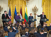 United States President Donald J. Trump, right, hosts a Joint Press Conference with the Baltic States Heads of Government, from left to right, President Raimonds Vejonis of Latvia, President Kersti Kaljulaid of Estonia, and President Dalia Grybauskaite of Lithuania in the East Room of the White House in Washington, DC on Tuesday, April 3, 2018.<br /> Credit: Ron Sachs / CNP