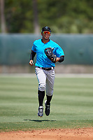 Miami Marlins centerfielder Víctor Víctor Mesa (32) jogs to the dugout during a Minor League Spring Training game against the New York Mets on March 27, 2019 at the Roger Dean Stadium Complex in Jupiter, Florida.  (Mike Janes/Four Seam Images)