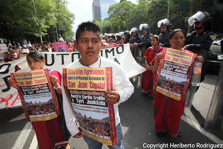 Triqui Natives protest on main Mexico City thoroughfares for the killing of Timoteo Alejandro, one of the main leaders of the Autonomous Municipality of San Juan Copala in southern state of Oaxaca, May 21, 2010. Paramilitaries have sieged San Juan Copala for six months and the federal government neither the state government  rule the region where the snipers have shot to death almost twenty people this year.  Photo by Heriberto Rodriguez
