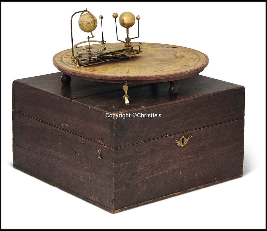 BNPS.co.uk (01202 558833)<br /> Pic: Christie's/BNPS<br /> <br /> Sir Patrick Moore's Orrery of 1794 Est £15,000.<br /> <br /> The iconic monocle worn by the late astrologer Sir Patrick Moore has been put up for sale along with several of his globes he used on TV's The Sky at Night.<br /> <br /> The legendary stargazer was well known throughout his career for wearing the old-fashioned single lens to correct the sight in one eye.<br /> <br /> The item - valued at £800 - is one of numerous personal effects from the eccentric astronomer's home in Selsey, West Sussex, that have been put up for auction as part of his estate.