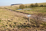 Chalk landscape scenery near Chitterne, Salisbury Plain, Wiltshire, England, UK sign no access for civilian vehicles