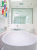 Mauro Puruccheti Jelly Babies appear perched, ready to dive into the giant oval bath tub