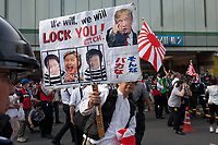 A right winger holds a sign in support of Donald Trump as Left-wingers and activists against the Emperor system in Japan demonstrate against the visit of US President, Donald Trump to Japan and the Emperor system. Shinjuku, Tokyo, Japan. Sunday May 26th 2019. A small group of about 50 activists who object to the Japanese Imperial family system was met by a counter-protest of right-wingers and nationalists.