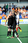 The Hague, Netherlands, June 01: Phil Burrows #18 of New Zealand is congratulates by Dean Couzins #8 of New Zealand after the end of the field hockey group match (Men - Group B) between the Black Sticks of New Zealand and Korea on June 1, 2014 during the World Cup 2014 at GreenFields Stadium in The Hague, Netherlands. Final score 2:1 (1:0) (Photo by Dirk Markgraf / www.265-images.com) *** Local caption ***