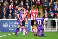 Tempers threaten to boil over between Port Vale's Mitchell Clark and Lincoln City's Neal Eardley<br /> <br /> Photographer Chris Vaughan/CameraSport<br /> <br /> The EFL Sky Bet League Two - Lincoln City v Port Vale - Tuesday 1st January 2019 - Sincil Bank - Lincoln<br /> <br /> World Copyright &copy; 2019 CameraSport. All rights reserved. 43 Linden Ave. Countesthorpe. Leicester. England. LE8 5PG - Tel: +44 (0) 116 277 4147 - admin@camerasport.com - www.camerasport.com