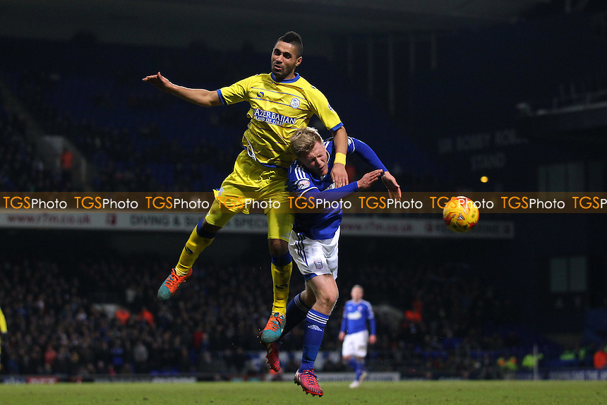Lewis McGugan of Sheffield Wednesday rises above Jonathan Parr of Ipswich Town - Ipswich Town vs Sheffield Wednesday - Sky Bet Championship Football at Portman Road, Ipswich, Suffolk  - 10/02/15 - MANDATORY CREDIT: Gavin Ellis/TGSPHOTO - Self billing applies where appropriate - contact@tgsphoto.co.uk - NO UNPAID USE