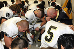 Palos Verdes, CA 11/14/09 - Coach Boyd and the Peninsula Panthers pray  in the locker room prior to their rivalry game against the Palos Verdes Sea Kings.