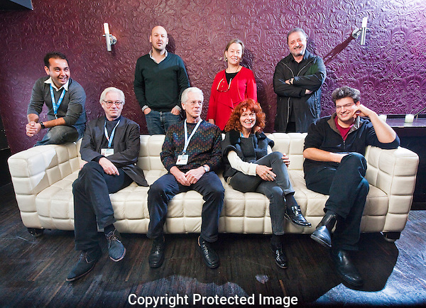 The Netherlands, Amsterdam, 23 November 2010. The 23rd International Documentary Film Festival Amsterdam (IDFA 2010). IDFA Mid-length Documentary Competition, First Appearance Competition and Green Screen Documentary Competition Juries. Backrow from left; Jawed Taiman (FA), Walter Stokman (FA), Outi Saarikoski (FA), Omar Amiralay (FA). Front row seated from left; Hank Camping (M-lD), Bill Nichols (FA), Nino Kirtadze (GRD) and Nikolaus Geyrhalter (GSD). Others not present. Photo: Bram Belloni /// © 2010 Bram Belloni, all rights reserved /// Copyright information: http://www.belloni.nl /// bram@belloni.nl /// +31626698929 /// Reference code: 101123002 IDFA Juries.jpg, The Netherlands/NLD, Amsterdam, 23NOV10