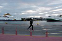 23rd April 2020, Mecklenburg-Vorpommern, Warnemünde: A single man jogs along the beach during the covid-19 pandemic