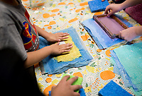 NWA Democrat-Gazette/CHARLIE KAIJO Second grade tudents create recycled paper during an art class, Monday, December 3, 2018 at Russell D. Jones in Rogers.<br />