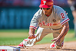 7 September 2014: Philadelphia Phillies outfielder Ben Revere slides safely back to first during game action against the Washington Nationals at Nationals Park in Washington, DC. The Phillies fell to the Nationals 3-2 in their final meeting of the season. Mandatory Credit: Ed Wolfstein Photo *** RAW (NEF) Image File Available ***