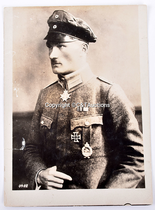 Bmth News (01202 558833)<br /> Picture:  C&TAuctions/BNPS<br /> <br /> German air ace Hans-Joachim Buddecke, who like most of his fellow airmen did not survive the war.<br /> <br /> Remarkable photographs revealing how the Germans used captured British tanks against us because theirs were no good have come to light over 100 years later.<br /> <br /> The British were the first to invent the tank in 1916 and a year later used them to overwhelm the enemy at the Battle of Cambrai in the First World War.<br /> <br /> Although the battle was a success for the British, the Germans captured several Mark IV tanks.<br /> <br /> Now black and white photos have emerged to show the German high command inspecting one the hulking machines in Berlin in 1918.<br /> <br /> Other pictures in the album depicts the early days of aerial warfare when hand grenades were dropped over the side of the cockpits by German pilots.