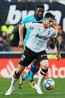 25th January 2020; Mestalla, Valencia, Spain; La Liga Football,Valencia versus Barcelona;  Maxi Gomez of Valencia CF is challenged by Defender Umtiti of FCB